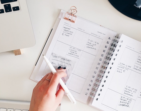 A planner on a white desk.