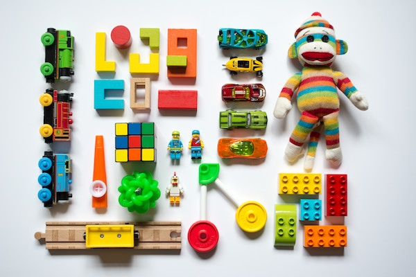 A collection of colourful toys against a white background.